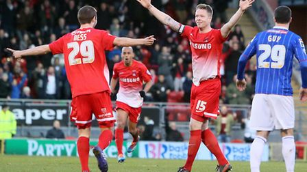 Jamie Ness celebrates his first Orient goal with captain Nathan Clarke. Pic by Simon O'Connor