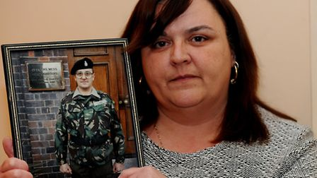 Karen LeSurf with a picture of her dad George Clarke.
