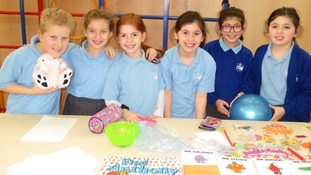 Year 5 pupils Ethan Gladstein, Jessica Gladstein and Yael Singer with Year 4 pupils Sophie Bracey, A