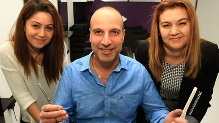 Erol Huseyin, centre, with wife Zulfiye and hairdresser Fatmanur Ciftci,right, at the opening of the