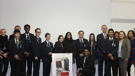 The pupils presented the French cultural attach� (5th from right) with this piece of artwork.