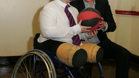 Disabled 13-year-old boy, Jamie Dawson, being presented with his first sports wheelchair by Danny Cr