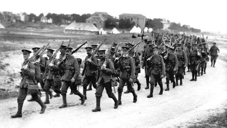 Photo of British infantrymen marching towards the front lines in the River Somme valley