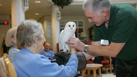 Keith Cole introduces Leo the Barn Owl to residents at the home