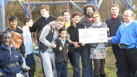 Redbridge 18 Plus members (holding the cheque, l-r: Kerry Mann, Francesca Barclay and Gary Silver) w