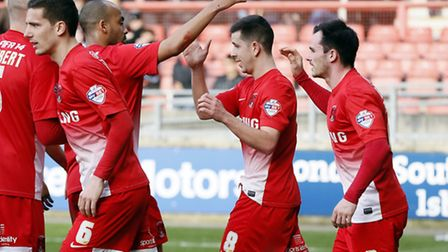 Lloyd James celebrates his successful penalty with his Orient team-mates. Simon O'Connor