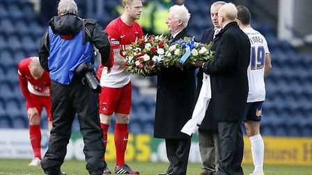 Captains Nathan Clarke and John Welsh present wreaths to the Finney family. Simon O'Connor