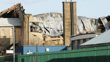 Collapsed warehouse roof after huge blaze at Canning Town