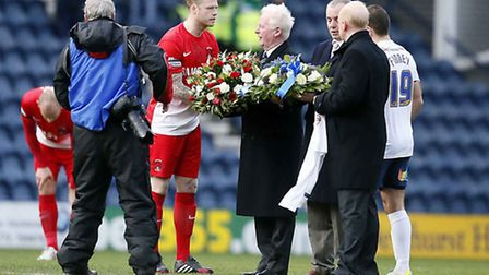 Captains Nathan Clarke and John Welsh present wreaths to the Finney family. Pic by Simon O'Connor