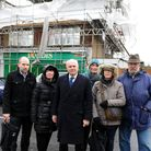 Iain Duncan Smith with a group of local residents in front of a Londis shop that was destroyed in a