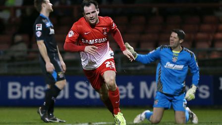 Chris Dagnall scores the second goal for Orient against Stevenage and celebrates (pic: Rob Newell/TG