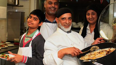 Fusion Foods Chef Manzoor, centre, and his team of volunteers Shae Daudia, left, Jay Diaz, and Noree
