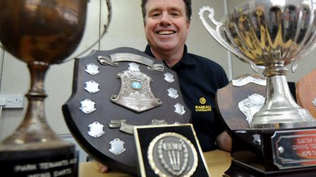 Alan Knight, business development manager at Randal Contracting with trophies that he hopes to reuni