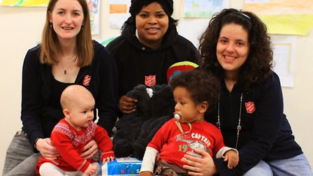 Naomi Clifton with baby Miriam,left, Marie Lungiambudi, and Panna Simon with David, appeal for more