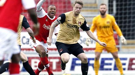 Nathan Clarke holds off Wes Thomas in the defeat at Rotherham. Simon O'Connor