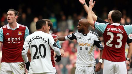 Andy Carroll is shown the red card by Howard Webb