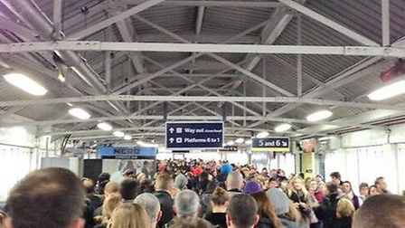 Tube passengers queue at Clapham Junction to catch a train to Stratford via the Overground