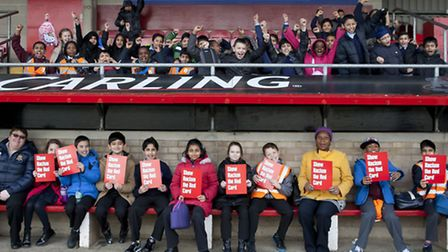 The schoolchildren holding up their red cards at the anti-racism day