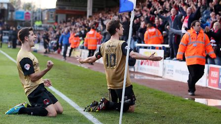 David Mooney celebrates one of his goals against Peterborough in the return game with Lloyd James. S