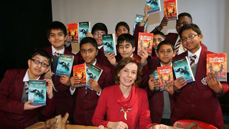 Author Michelle Paver pictured with students at Ilford County High school