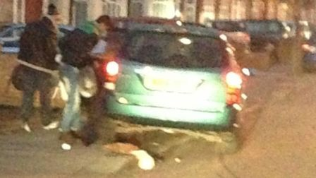 Two of the men seen leaving the vehicle. Picture: Bhavna Balsod