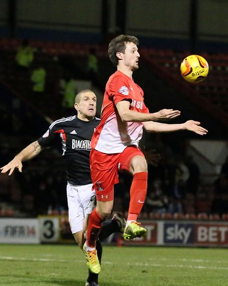 Orient substitute David Mooney is challenged by Bristol City's Adam El-Abd as he tries to get his te