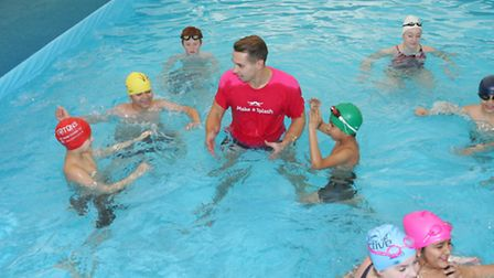 Olympian Adam Whitehead gives a swimming lesson in the new pool at Wanstead