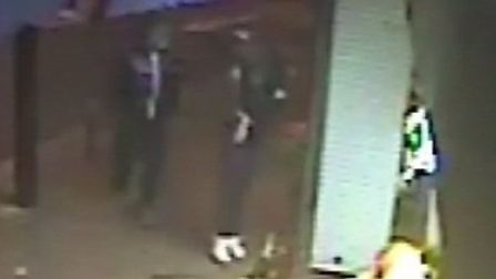 The two men enter the shop, one pulls a sawn-off shotgun from his trousers