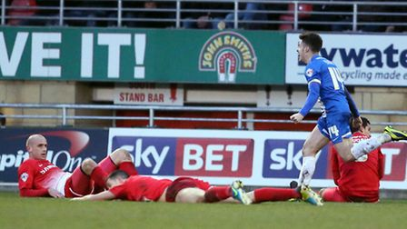 Orient players were in despair after Tommy Rowe's winner for Peterborough. Simon O'Connor