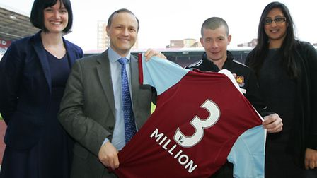 Pensions minister Steve Webb visiting West Ham FC with staff, Julie O'Leary, Dougie Robertson, and