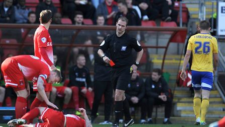Brentford's James Tarkowski (right) leaves the pitch after being shown the red card by referee Rober