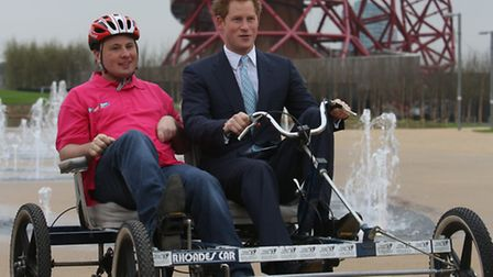 Terry Sullivan helps His Royal Highness Prince Harry experience a Bikeworks bike in Queen Elizabeth