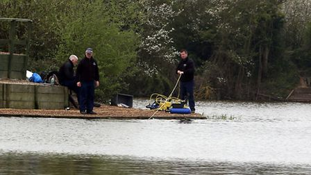 Divers searching the water