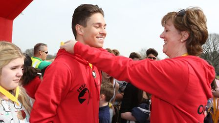 Onesie walk with Joey Essex for Child Bereavement UK. Joey Essex with Anne Chalmers from Child Berea