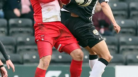 Scott Cuthbert challenges for a header with Notts County's Nathan Tyson. Pic by Simon O'Connor