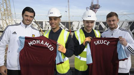Apprentices George Skuce and Mohamed Mohamed at Olympic Stadium with West Ham playersGeorge McCart