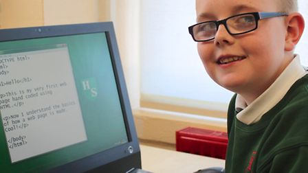 Kieran Schofield-Hawe in year 4 has been learing how to code. Picture: John Moore