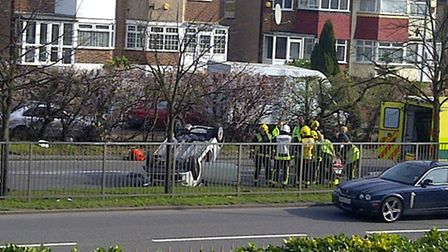 A car was overturned this morning in South Woodford and a man in his 30s was taken to hospital.