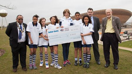 From left: Clllr Lester Hudson, pupils from Chobham Academy and Olympic cycling champion Joanna Rows
