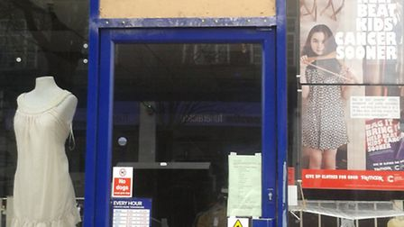 The boarded up Cancer Research UK store in Elm Parade following the break-in.
