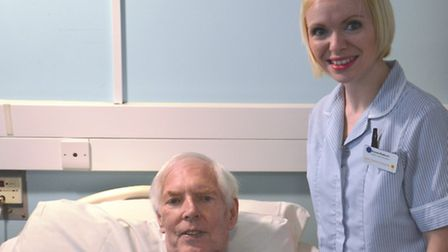 Tom Eaton with health care assistant Aimee Mabbort in the inpatient unit (IPU)