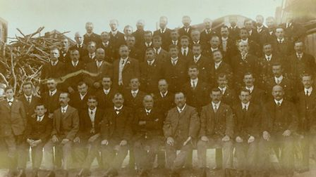 Three generations of the Davis family in 1914. Far left standing up is John's grandfather, fifth fro