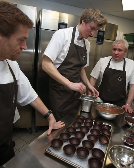 Executive Chef Brendan Fyldes and Creative director Michael Wignall look on as I attempt help prepar