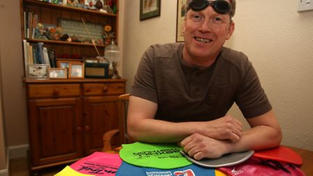 Colin Stringer, 52 with all his swimming hats
