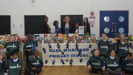 Pupils from Ellen Wilkinson with the food they've collected for Newham foodbank