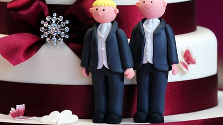 Groom cake decorations on a wedding cake. Picture: PA Archive/Rui Vieira.