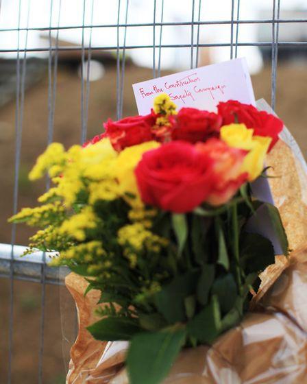 A floral tribute left by the Construction Safety Campaign in memory of the workers killed at the Doc