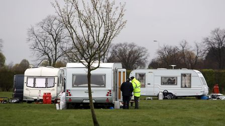 Police with travellers at Hainault Recreation Ground on Forest Road.