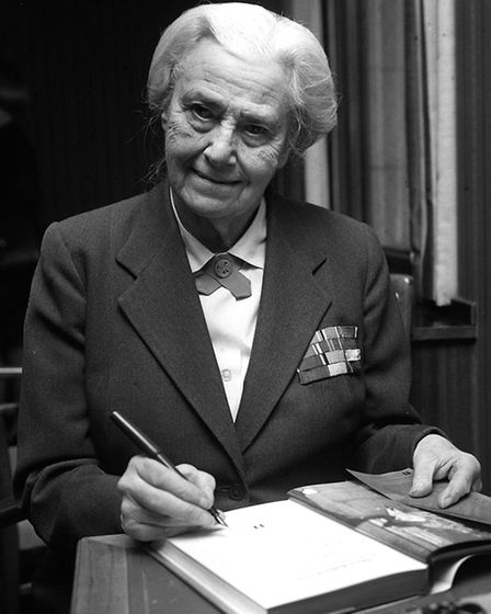Lady Olave Baden-Powell, 82, autographing a copy of her biography at Hodder and Stoughton's in Londo