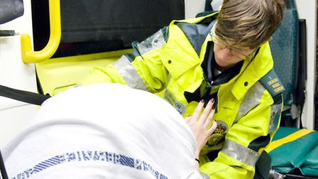 A paramedic dealing with a drunk patient.